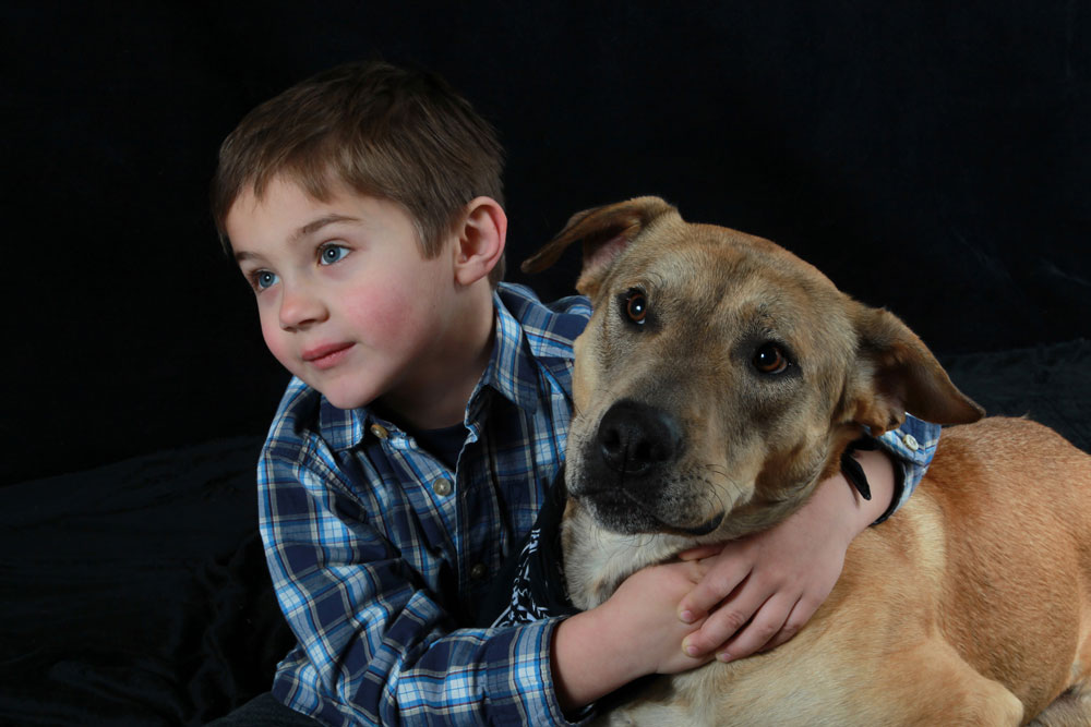 young boy and dog